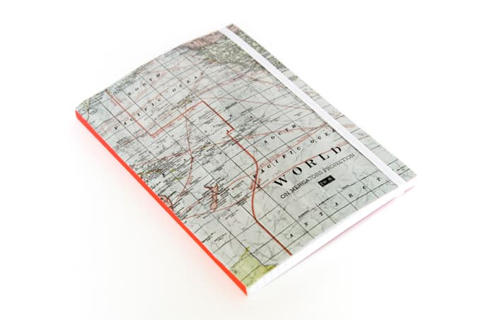 Revamp a free promo notebook using a map and Mod Podge - so easy and budget friendly!