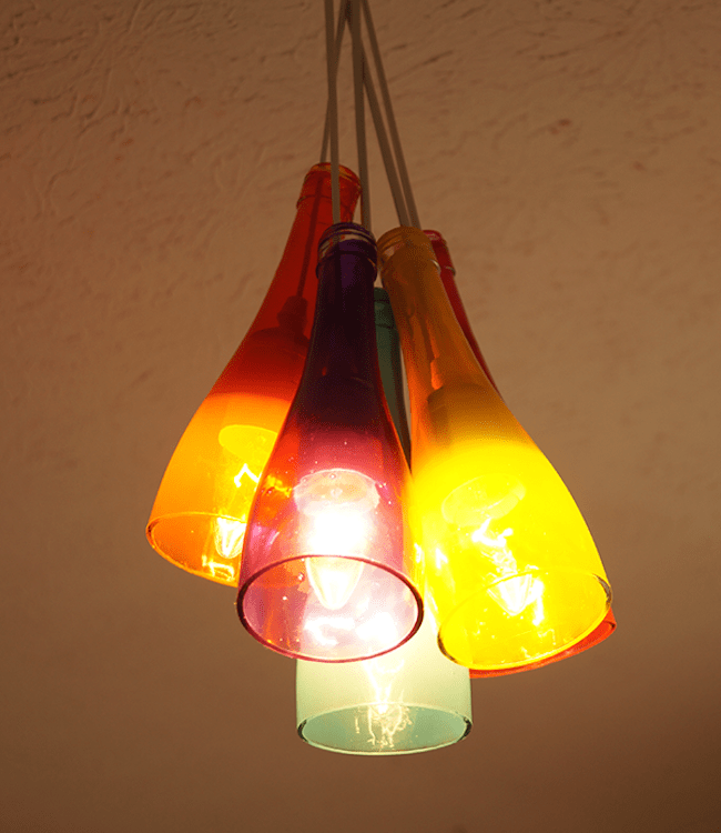 Make a DIY chandelier using cut wine bottles and Mod Podge Sheer Colors