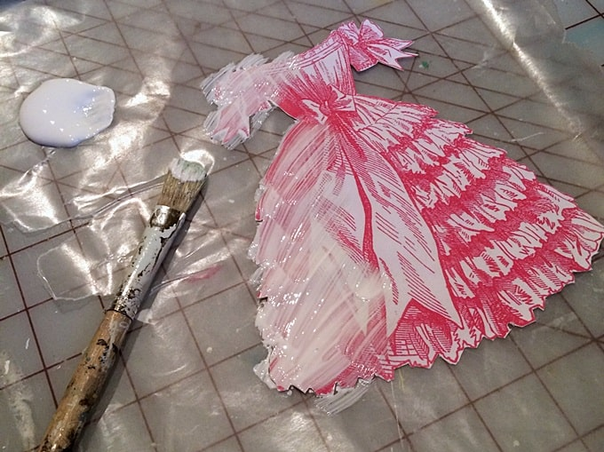 Applying photo transfer medium to an image of a dress