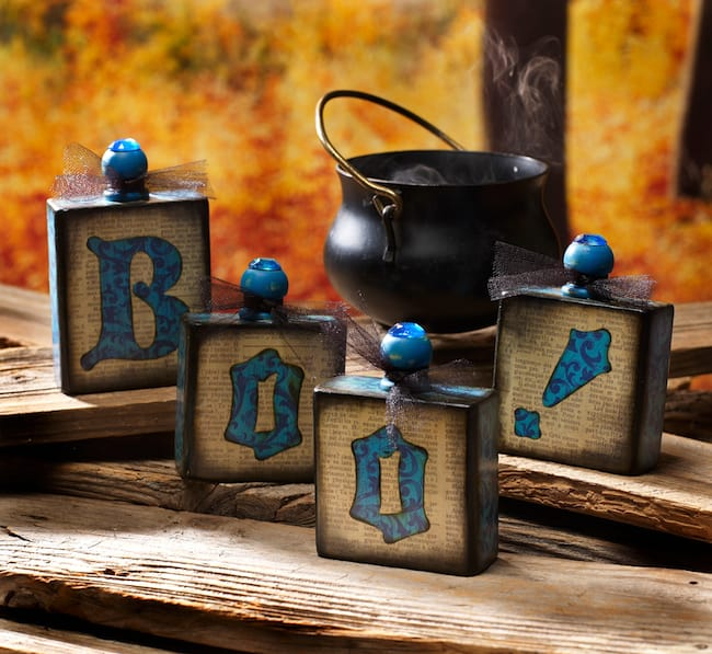 Use leftover scrap wood to make these fun Halloween blocks that look like potion bottles! You'll use scrapbook paper and Mod Podge to decorate.