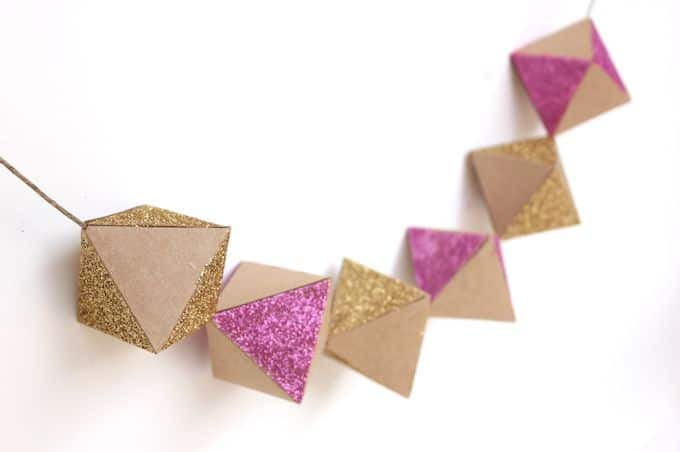Make a bannerglittery geometric garlandMod Podge Rocks