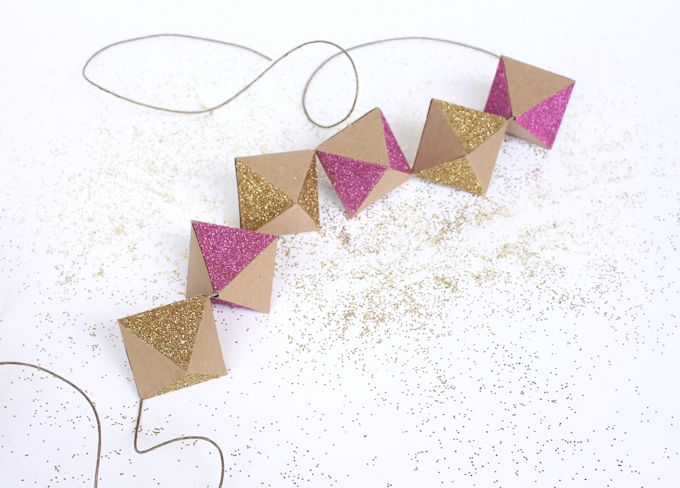Do you want to learn how to make a simple decoration for your next party? Learn how to make this easy glittery geometric paper garland!