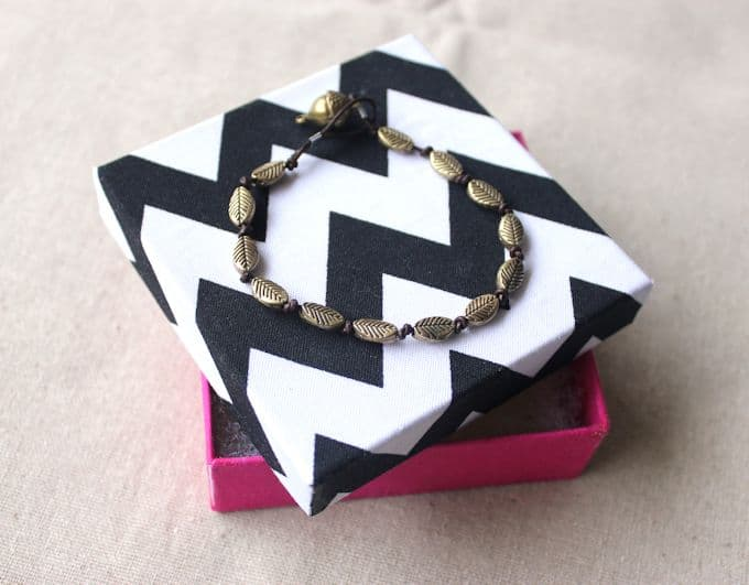 You can cover any sized box in fabric and use them to give jewelry - by making these DIY gift boxes with Mod Podge!