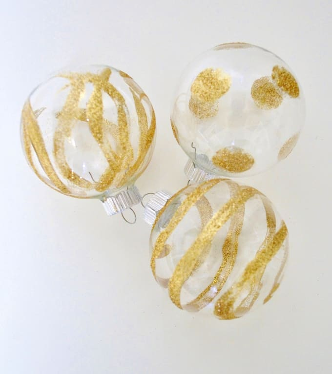 Do you love the look of sparkle and bling on your tree? Add a little glitter and Mod Podge to create these pretty handmade ornaments!