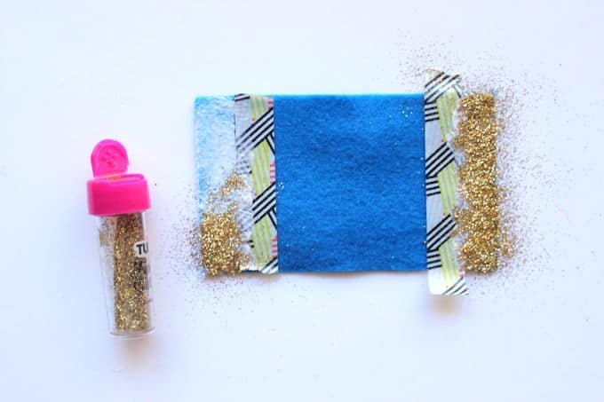 Mod Podge on blue felt with gold glitter sprinkled on top