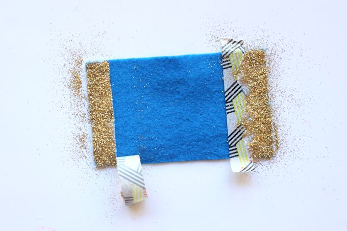 Removing washi tape from a felt bow with gold glitter
