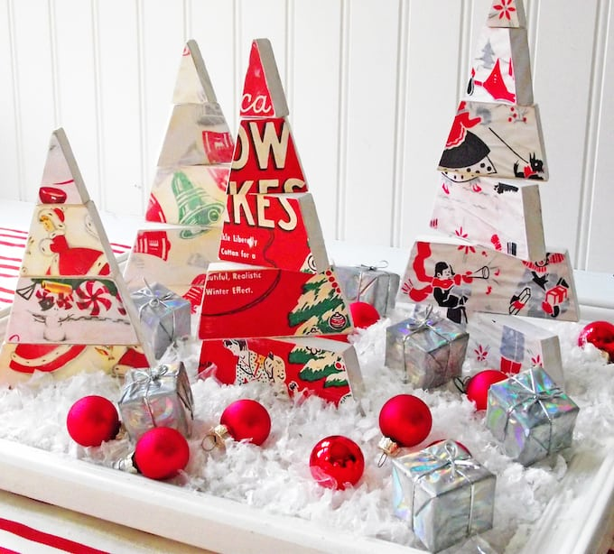 DIY Christmas tree centerpiece with faux snow, ornaments, and small packages