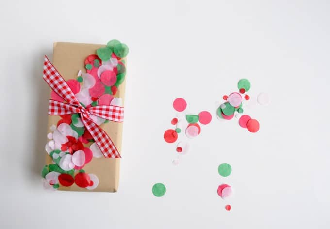 If you tend to do things a little last minute like me, here's an idea for embellishing wrapped gifts. This DIY confetti wrap is so fun and colorful!