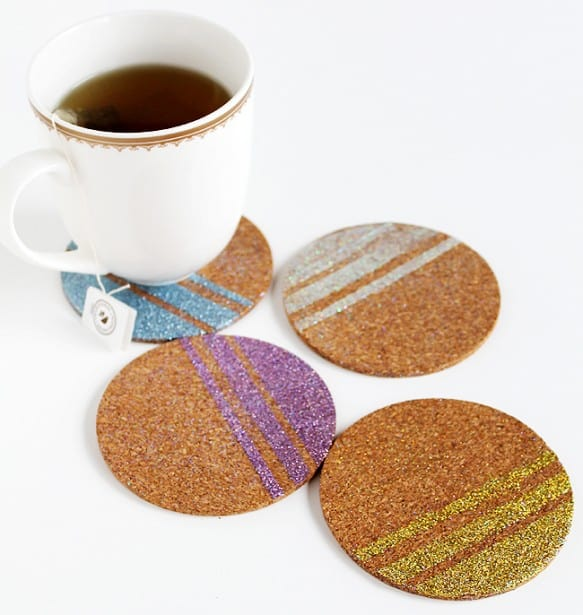 Make these decoupage glitter DIY coasters to help your guests or family members keep their drinks straight - no more guessing whose drink is whose.