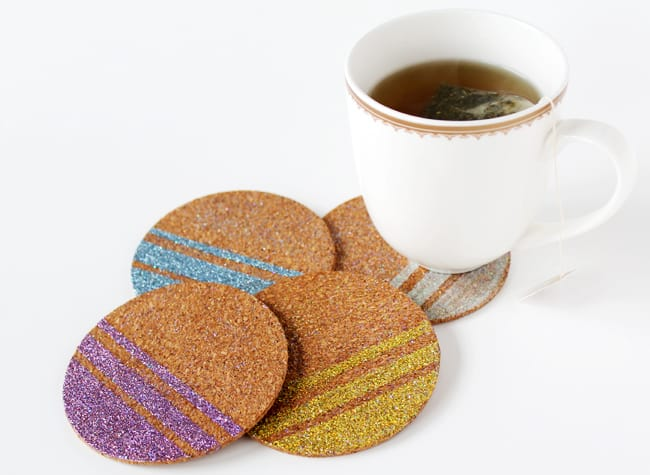 Make these glitter DIY coasters to help your guests or family members keep their drinks straight - no more guessing whose drink is whose.