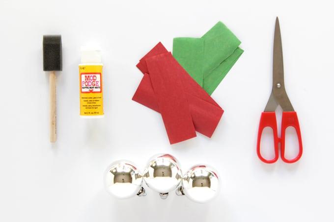Foam brush, Mod Podge Matte, tissue paper, scissors, and silver Christmas ornaments