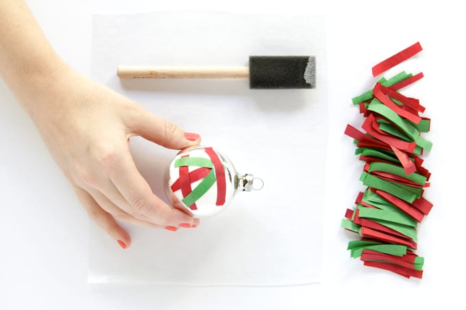 Add tissue paper confetti to the ornament base with Mod Podge