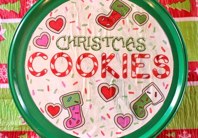 Once you are done with an old popcorn tin, what do you do with it? Turn it into a cookie container in this fun Christmas craft using Mod Podge!
