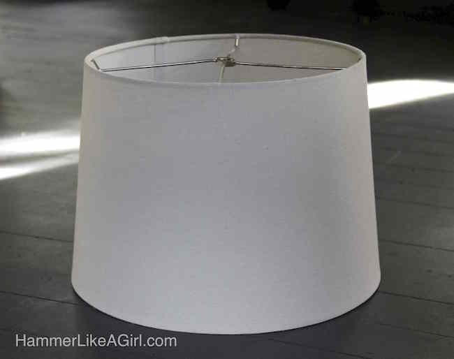 White lampshade sitting on a table