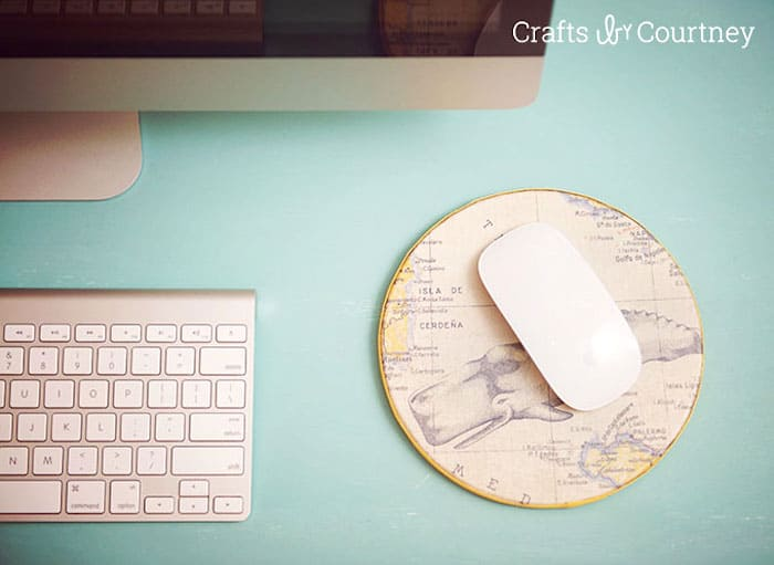 Use a cork round and your favorite scrapbook paper (along with Mod Podge) to make these easy and budget friendly DIY mouse pad!