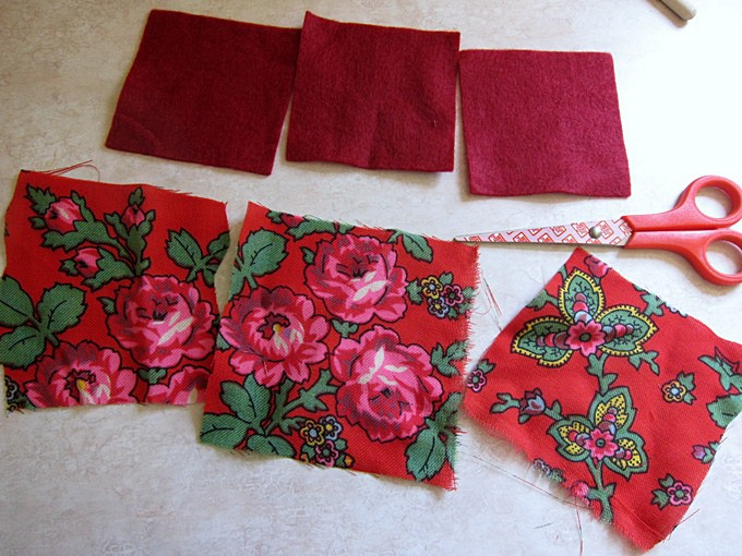 Cut out squares of fabric and felt using a pair of scissors