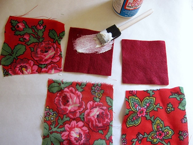 Brush Mod Podge onto fabric with a foam brush