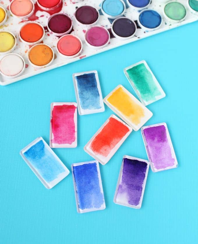 Make these cool watercolor DIY magnets using Podgeable shapes and Paper Mod Podge. They look great in a rainbow palette!
