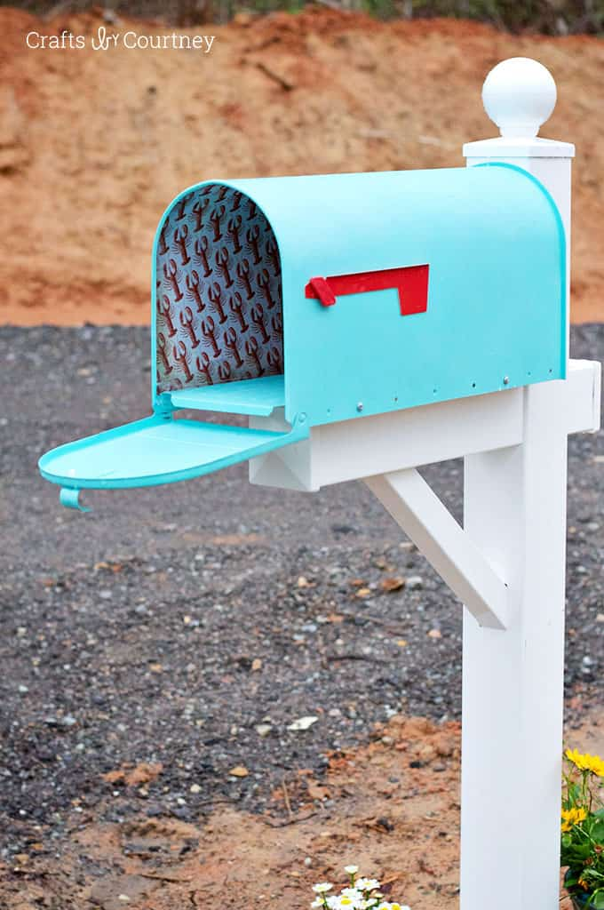 Courtney just moved into a new home and gave it a coastal DIY mailbox makeover with paint, Mod Podge Outdoor, and paper. It looks awesome!