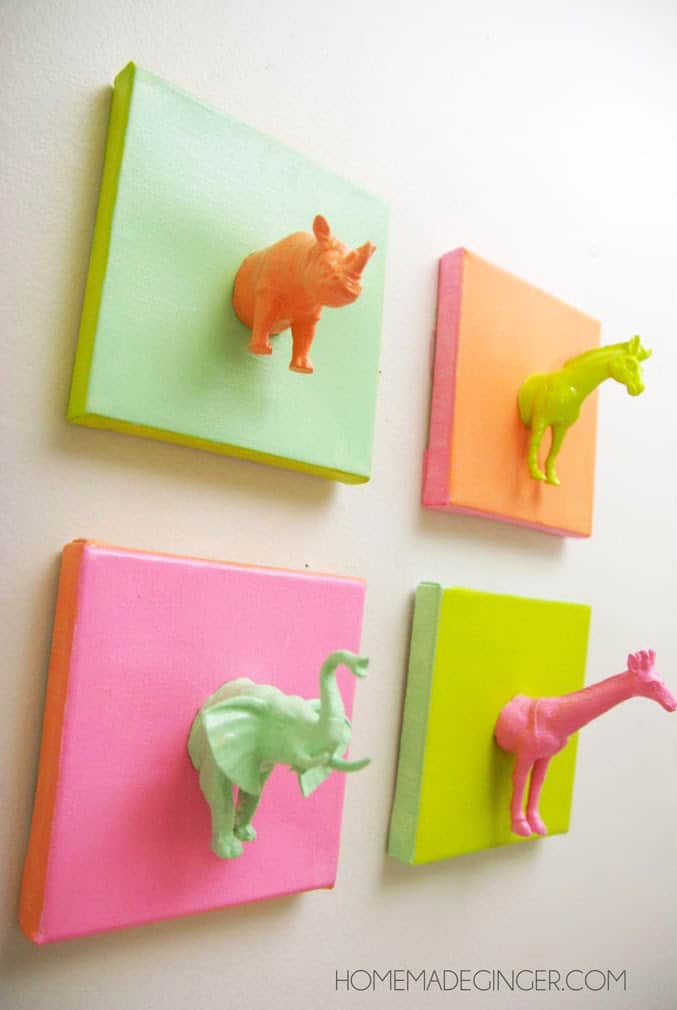 Plastic animals on mini canvases