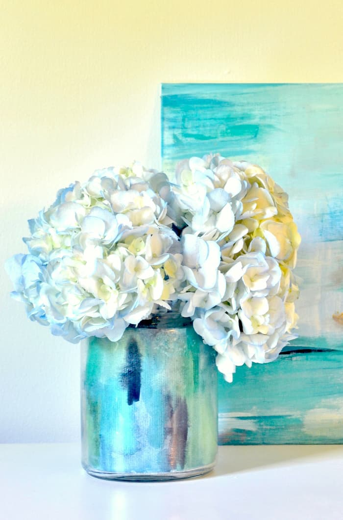 Bring in spring with a beautiful DIY vase you can make with Mod Podge and painted watercolor paper. No skillset required!