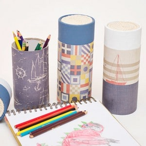 Decorate old cardboard tubes with your favorite scrapbook papers and Mod Podge - your littles will love this easy organization kids craft idea!