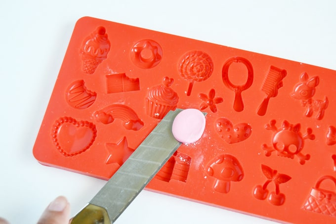 Press clay into the silicone mold