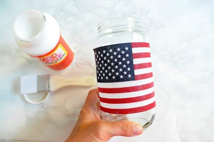 Seal your mason jar lanterns with Mod Podge