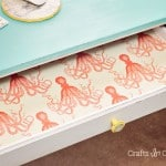 Use Mod Podge and your favorite fabric pattern to create these unique fabric lined drawers - I love the special surprise every time you open one!
