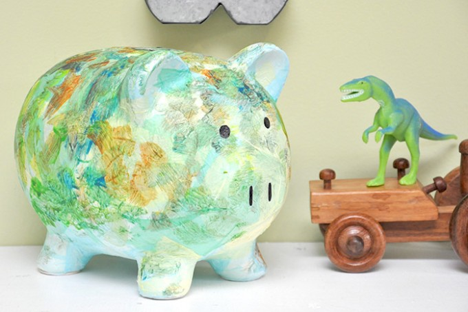 In this DIY piggy bank project we grabbed a thrift store find and made it fit kids' room decor with paint and Mod Podge!