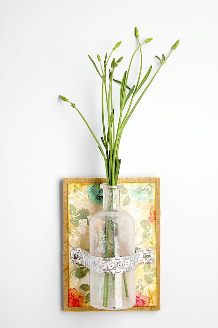 Display fresh flowers and herbs in your home this summer with an easy-to-make wall vase using a recycled bottle.