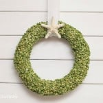 If you're looking for a budget friendly DIY wreath, this is your project! You'll use split peas, Mod Podge, and supplies from the dollar store.