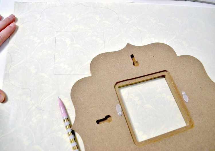 Trace the frame on the back of the scrapbook paper with a pencil