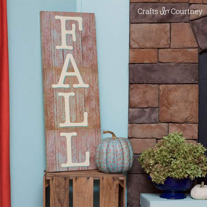 Use wood themed scrapbook paper to make this unique DIY sign for fall - so pretty and festive, you'll want to keep it up all year long!