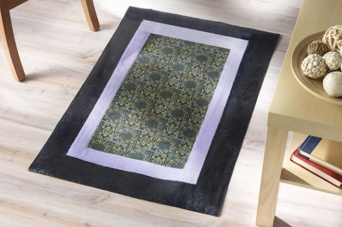 Learn how to make a Mod Podge floor cloth using linoleum and your favorite fabrics. A perfectly unique alternative to a standard rug!