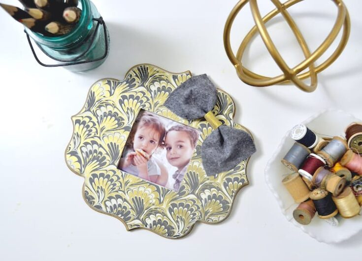 If you've ever found a beautiful piece of paper begging to be used in a craft, this DIY photo frame is perfect - so easy to make with Mod Podge!