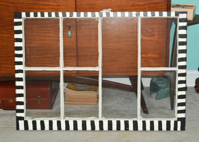 Window painted with black stripes around the edges