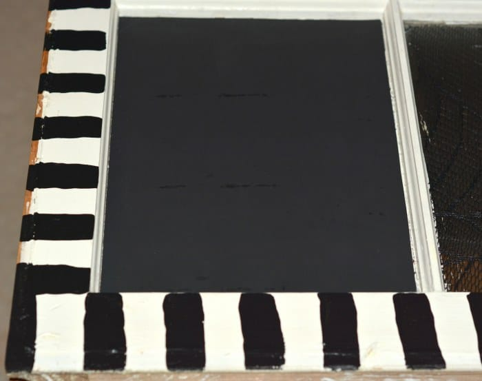 Chalkboard cardstock applied to a window pane with Mod Podge