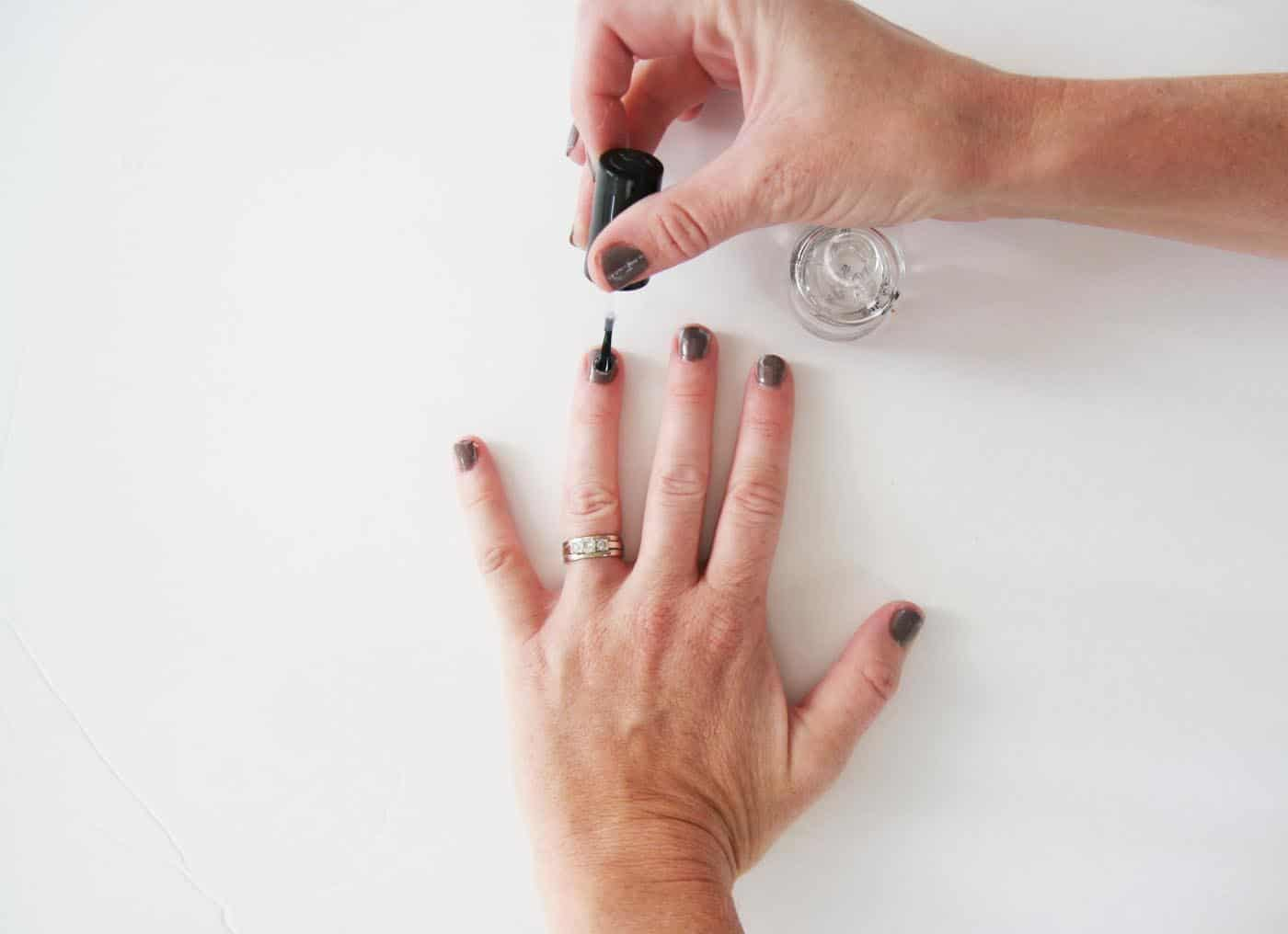 Transform any nail polish to glow at night with this easy DIY glow in the dark nail polish tutorial.