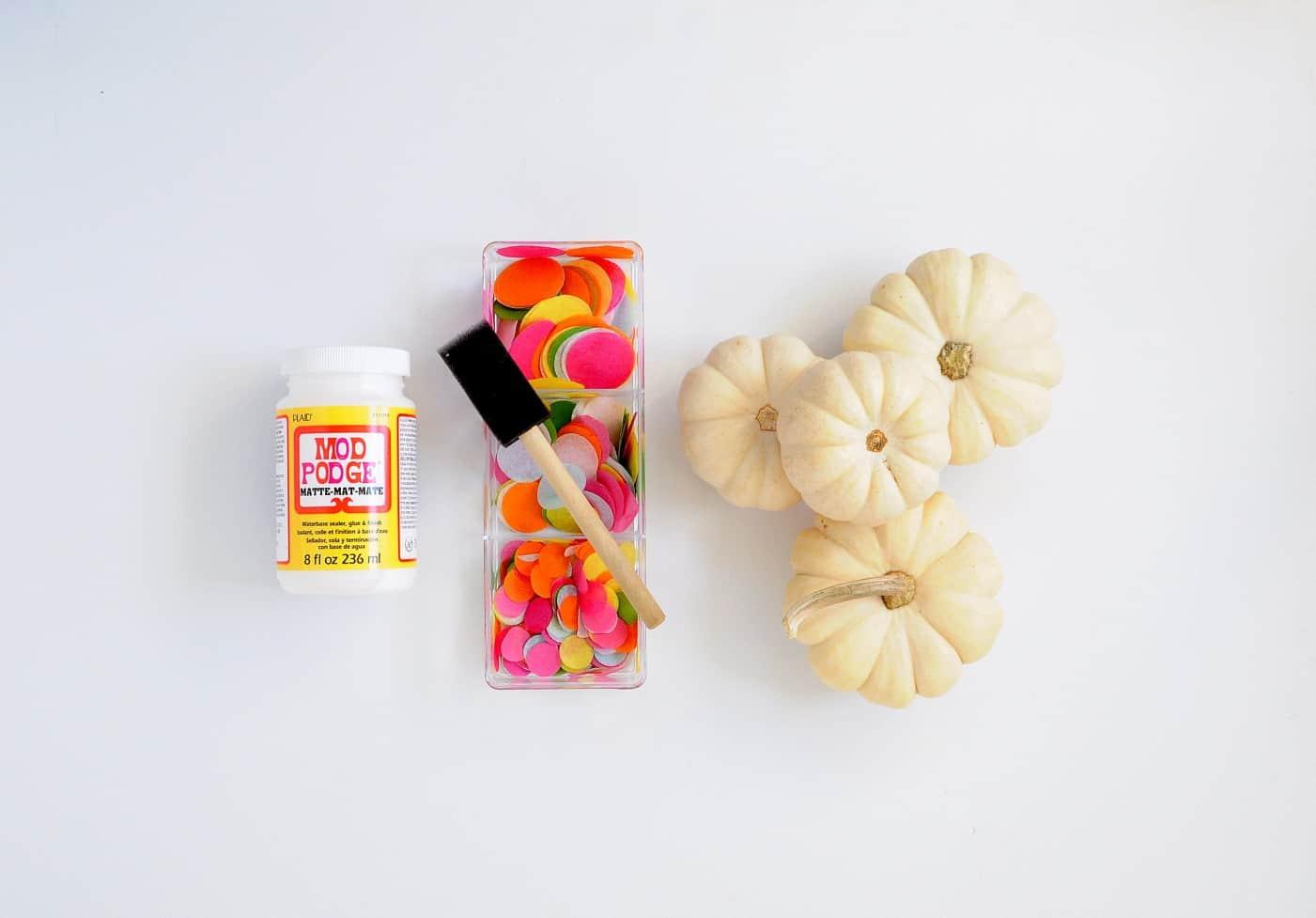 Mod Podge Matte, confetti, and small white pumpkins