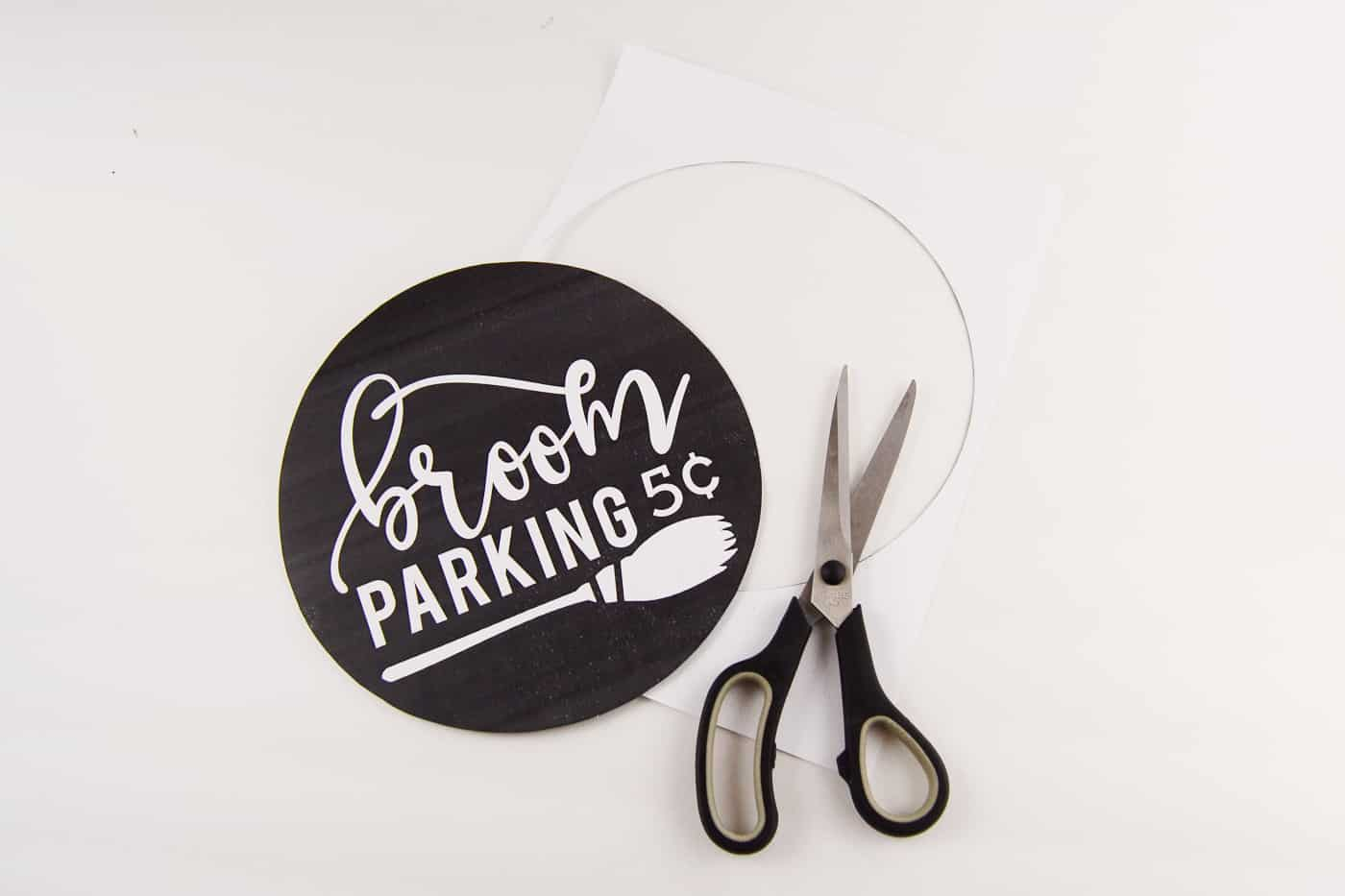 Broom parking printable cut out with a pair of scissors