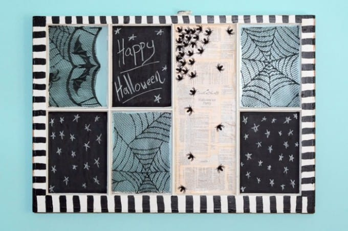 Use an old window to create a fun and spooky DIY Halloween display - it can be customized to your style easily by the lace and book style you choose!