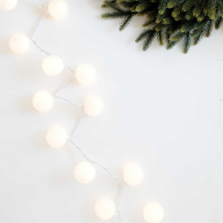 Are you ready to start decorating for Christmas yet? These DIY Christmas lights are easy to make and look like you have glittery snowballs decorating your home!