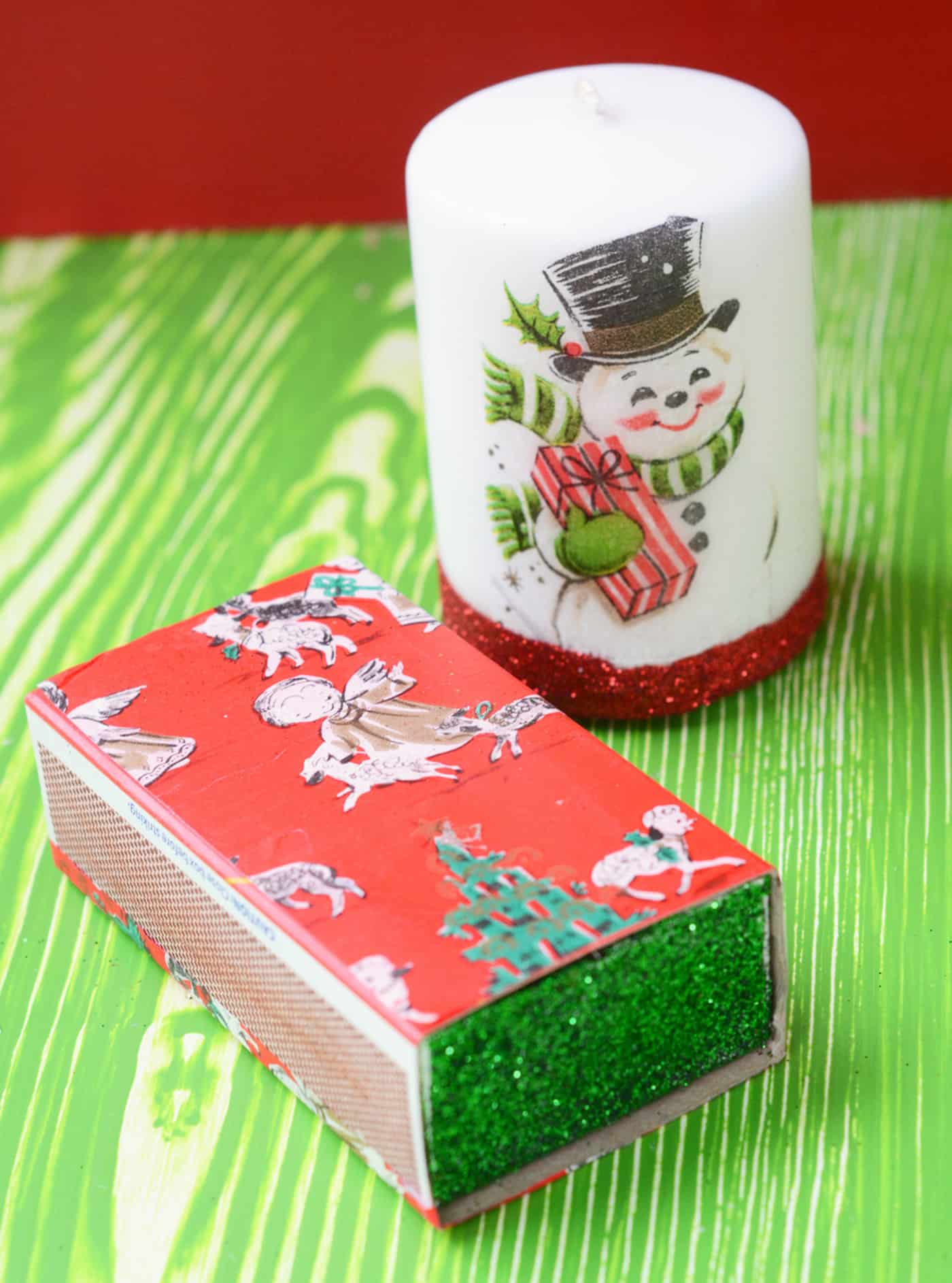 Use vintage Christmas wrapping paper and Mod Podge to decoupage pretty holiday candles and little matchbooks. These are so easy to make!