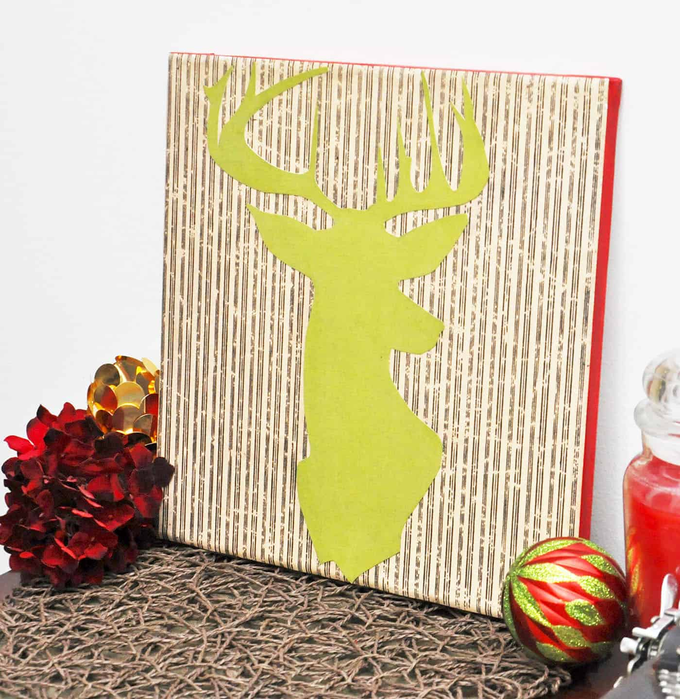 'Tis the season for all things deer inspired! You can create this simple DIY wall art piece in just one afternoon, using your favorite colors to customize.