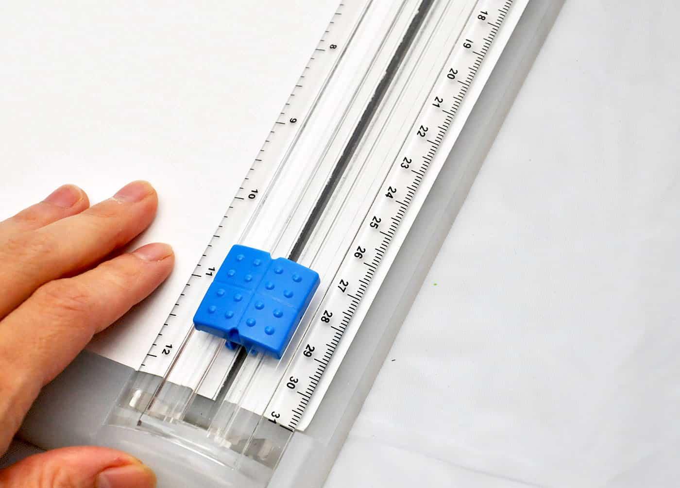 Use a paper cutter to trim the scrapbook paper