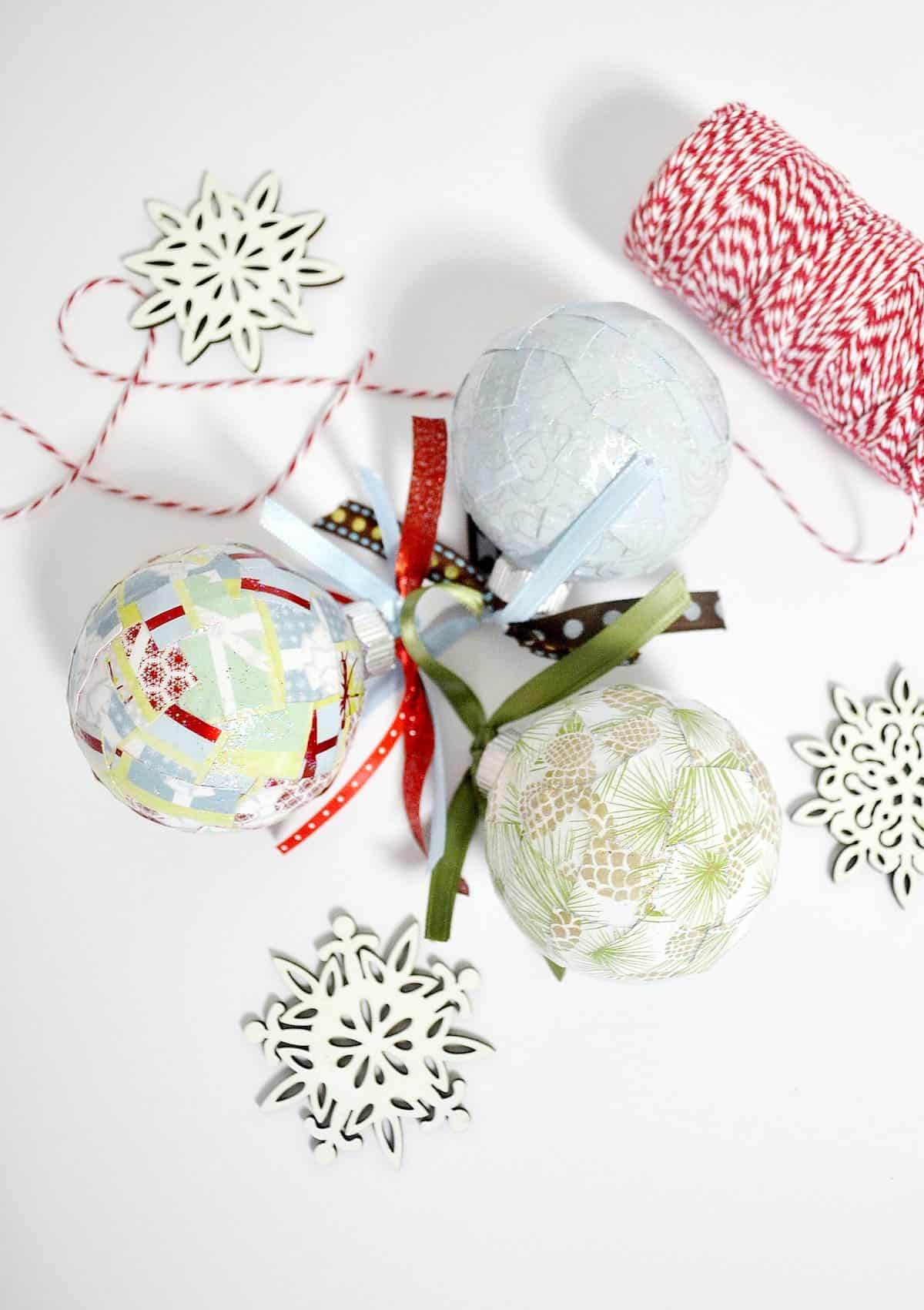 Use paper scraps you've saved or small squares of your favorite holiday scrapbook papers to make these unique DIY Christmas ornaments!