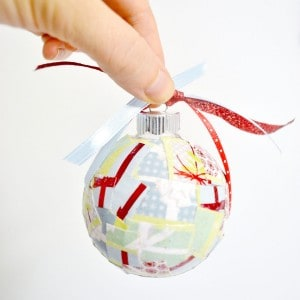 Use paper scraps you've saved to make these unique DIY Christmas ornaments! Very easy using glass balls and Mod Podge. Fun for kids . . . make for gifts or for the Christmas tree. Can be customized for rustic or vintage decor!