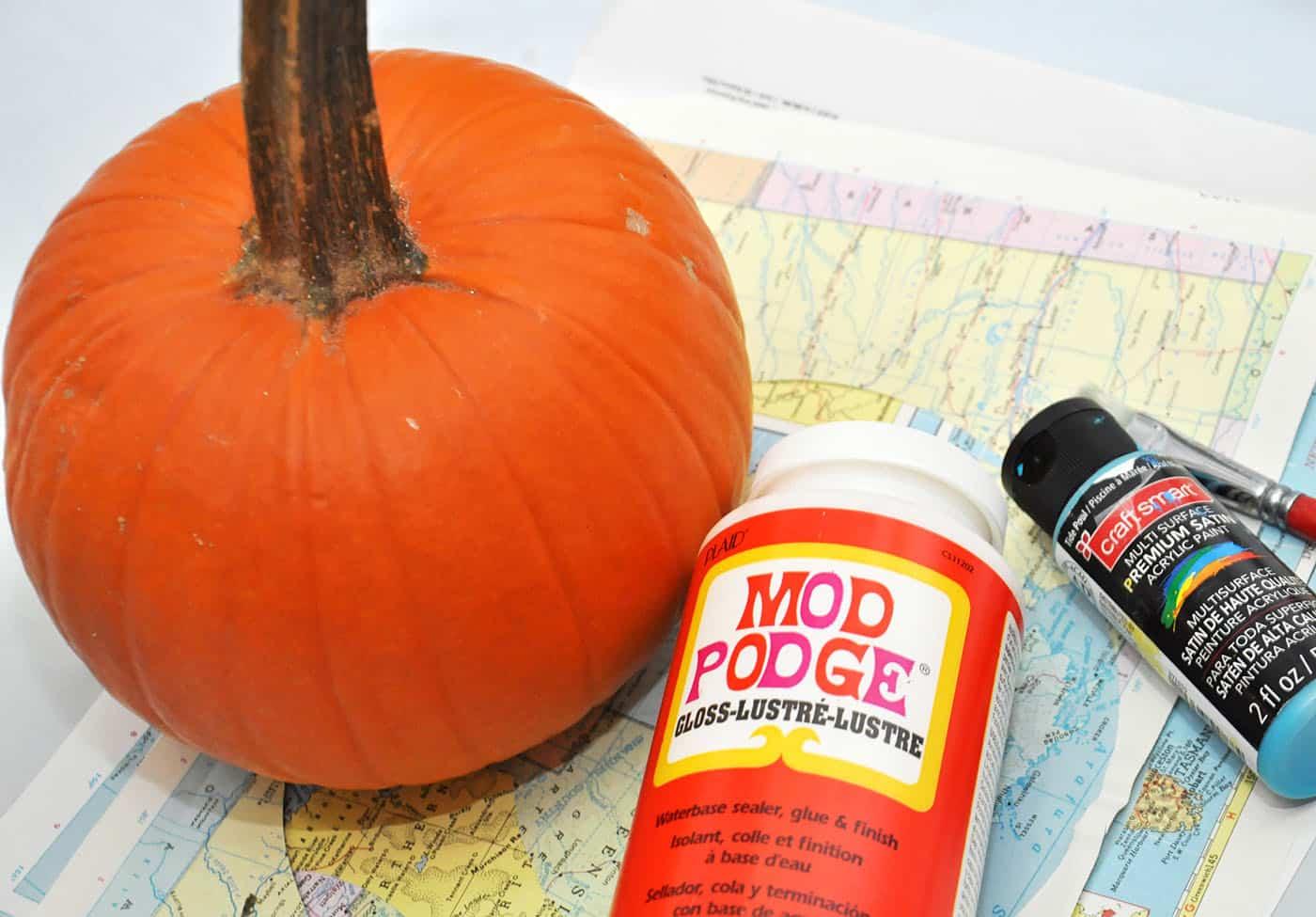 Supplies for making a Mod Podge pumpkin