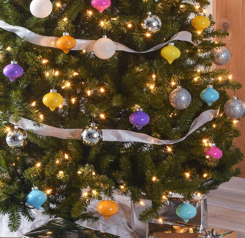 This colorful Christmas tree was inspired by a vintage palette! Learn how to make simple drop ornaments to create a tree just like this one.